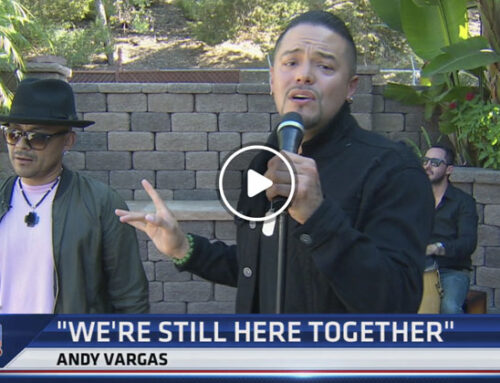 Andy Vargas, lead singer of Santana, performs with R&B singer Frankie J.