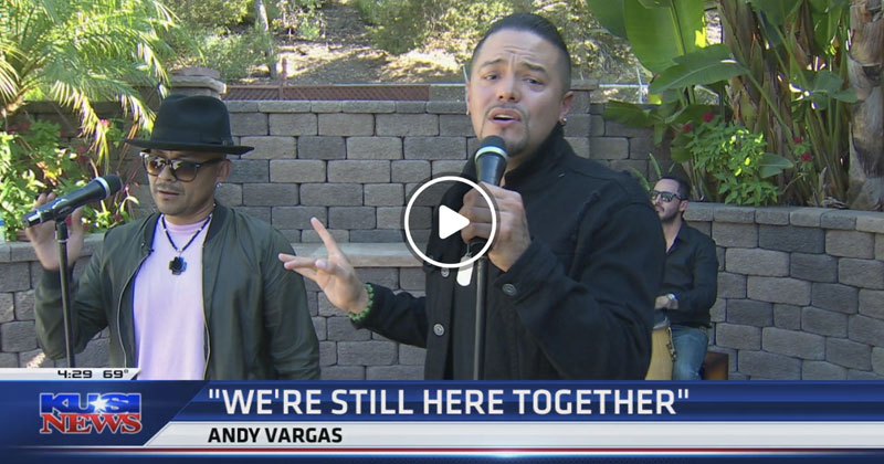 Andy Vargas, lead singer of Santana, performs with R&B singer Frankie J.